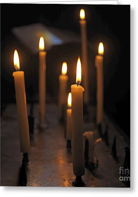 Votive Candles Greeting Cards - Candles burning in a church Greeting Card by Bernard Jaubert