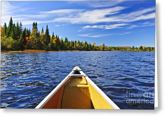 Canoe Greeting Cards - Canoe bow on lake Greeting Card by Elena Elisseeva