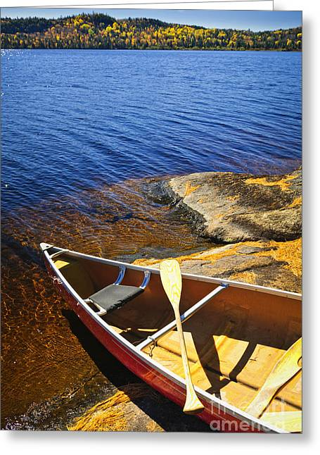 Canoeing Photographs Greeting Cards - Canoe on shore Greeting Card by Elena Elisseeva