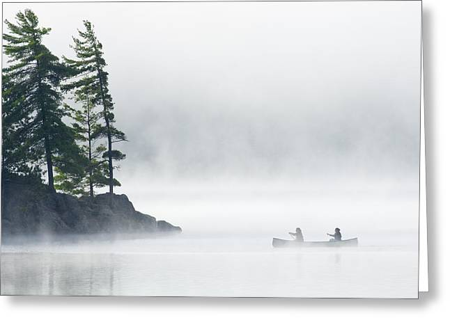 Canoe Photographs Greeting Cards - Canoeing Through Fog On Lake Of Two Greeting Card by Mike Grandmailson