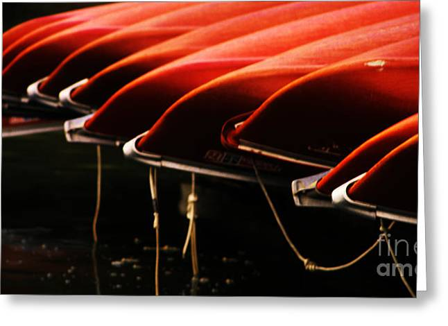 Canoes Of Red Greeting Card by Bob Christopher