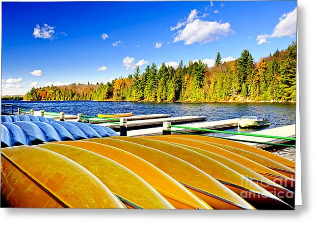 Canoe Greeting Cards - Canoes on autumn lake Greeting Card by Elena Elisseeva
