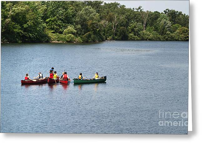 Green Canoe Greeting Cards - Canoes on lake Greeting Card by Blink Images