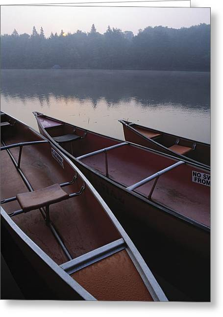 Canoe Photographs Greeting Cards - Canoes On Still Water Greeting Card by Natural Selection John Reddy