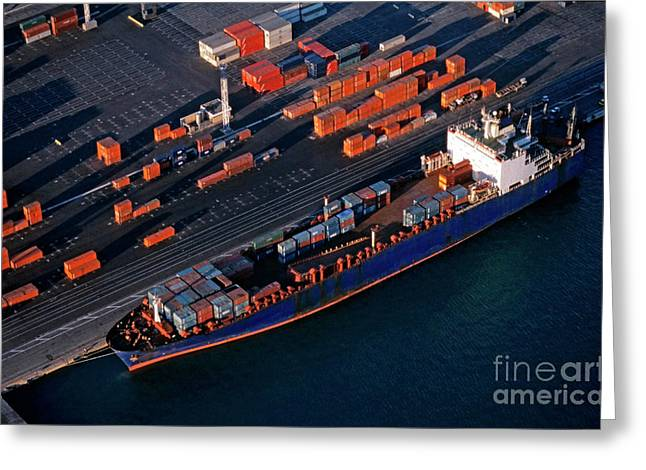 Freight Transportation Greeting Cards - Cargo at quay loading freight container at port Greeting Card by Sami Sarkis