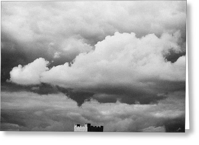 carrickfergus castle under a stormy sky county antrim northern ireland uk viewed from the sea Greeting Card by Joe Fox