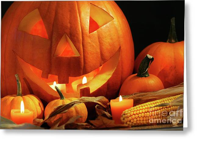 Stars Fall Greeting Cards - Carved pumpkin with candles Greeting Card by Sandra Cunningham