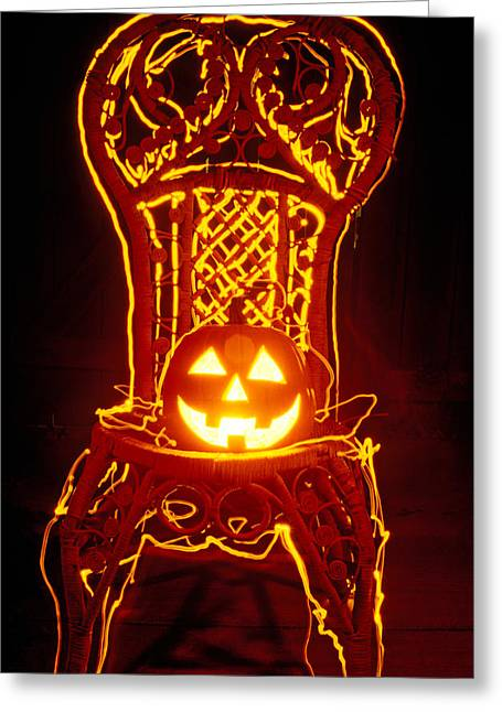 Pumpkins Greeting Cards - Carved smiling pumpkin on chair Greeting Card by Garry Gay