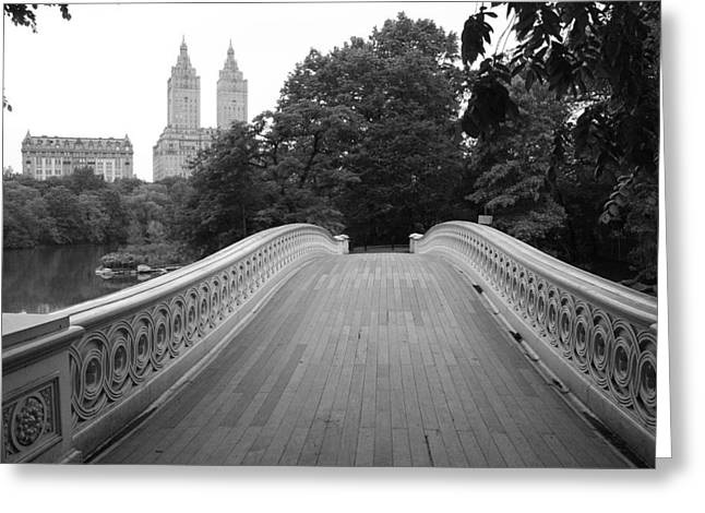 Bow Greeting Cards - Central Park Bow Bridge with The San Remo Greeting Card by Christopher Kirby