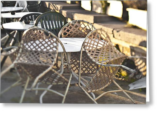 Al Fresco Greeting Cards - Chairs Leaning Up Against a Table Greeting Card by Eddy Joaquim