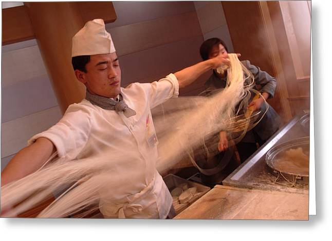 Food Industry And Production Greeting Cards - Chef Stretches Dough As He Makes Fresh Greeting Card by Richard Nowitz