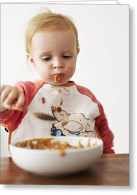 Apron Greeting Cards - Child Eating Dinner Greeting Card by Ian Boddy