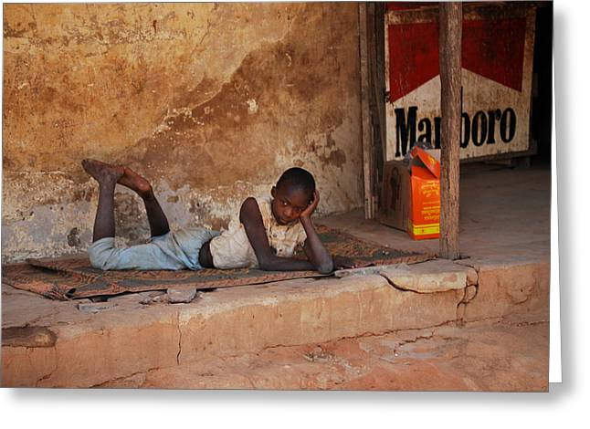 Naivety Greeting Cards - Child in the street Greeting Card by Kamel Rekouane