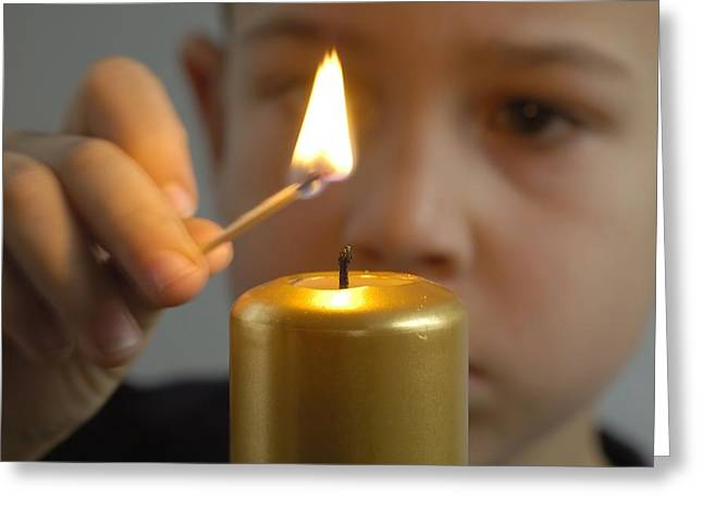 Concentration Greeting Cards - Child lights a candle Greeting Card by Matthias Hauser