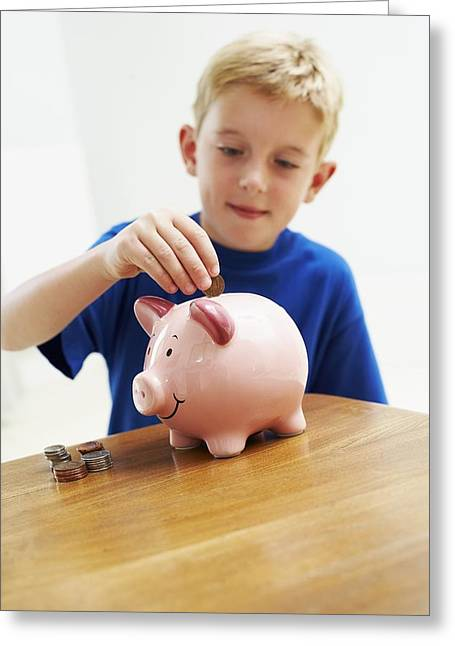 Young Money Greeting Cards - Child With A Piggy Bank Greeting Card by Ian Boddy