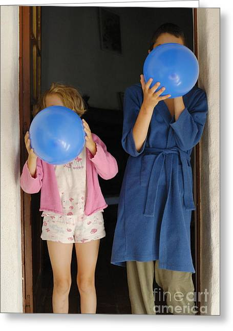 Bathrobe Greeting Cards - Children blowing up balloons Greeting Card by Sami Sarkis