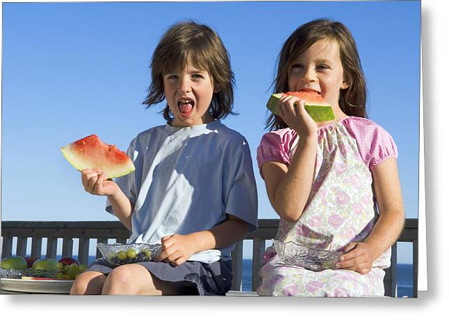 Watermelon Greeting Cards - Children Eating Watermelon Greeting Card by Lawrence Lawry