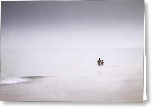Foggy Beach Greeting Cards - Children playing in the silver sea Greeting Card by Guido Montanes Castillo