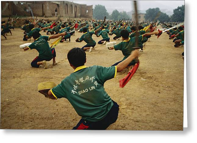 Human Actions And Reactions Greeting Cards - Children Practice Kung Fu In A Field Greeting Card by Justin Guariglia