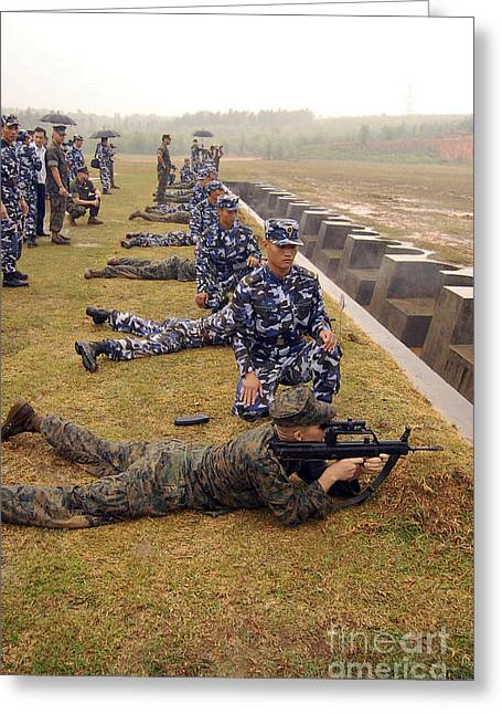 Brigade Greeting Cards - Chinese Marines Assist U.s. Marines Greeting Card by Stocktrek Images