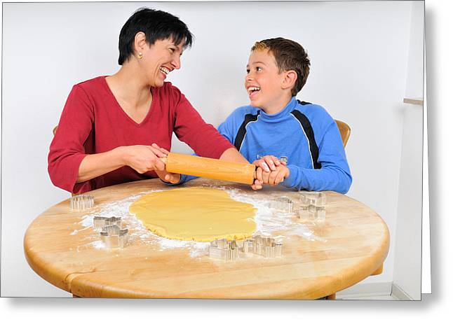 Christmas Baking - Mother And Son Laughing Greeting Card by Matthias Hauser