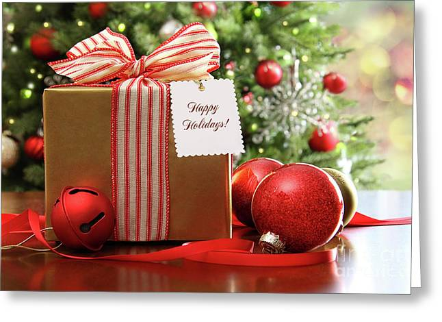 Surprise Greeting Cards - Christmas gift sitting on a table  Greeting Card by Sandra Cunningham