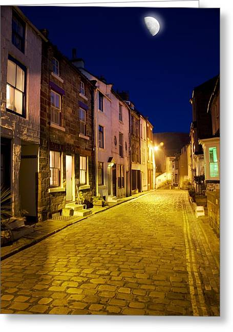 Moonlit Night Greeting Cards - City Street At Night, Staithes Greeting Card by John Short