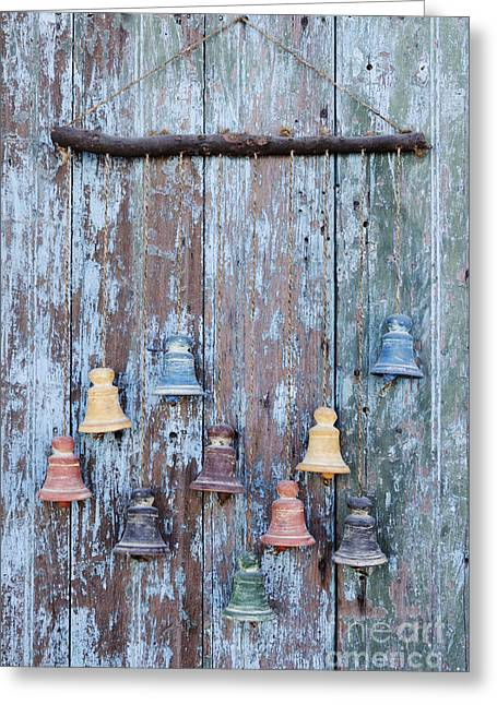Clay Bells On A Weathered Door Greeting Card by Jeremy Woodhouse