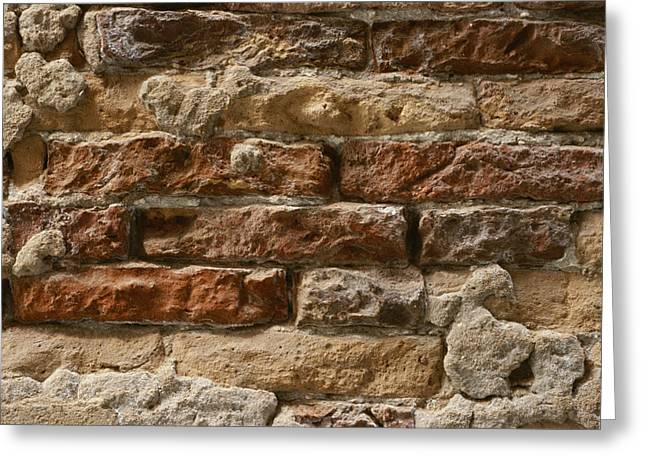 Concept Photographs Greeting Cards - Close-up Of An Eroded Brick Wall Greeting Card by Todd Gipstein