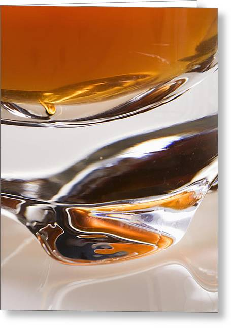 Glass Table Reflection Greeting Cards - Close-up Of The Base Of A Glass Filled Greeting Card by Michael Interisano