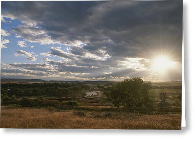 North Fork Greeting Cards - Clouds And Sun Over Clarks Fork Greeting Card by Annie Griffiths