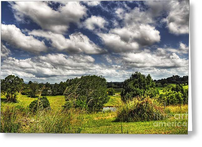 Lush Green Greeting Cards - Clouds Floating over Green Countryside Greeting Card by Kaye Menner