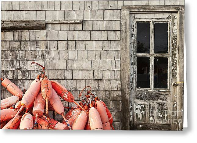 Coastal Shanty And Buoys. Greeting Card by John Greim