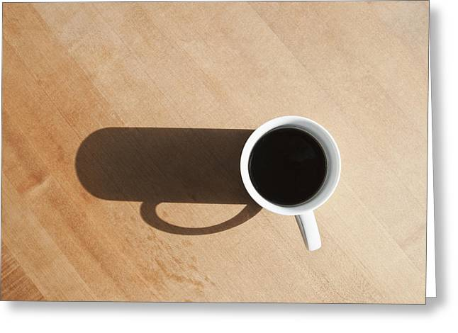 Casting A Shadow Greeting Cards - Coffee Cup and Shadow on a Table Greeting Card by Jetta Productions, Inc
