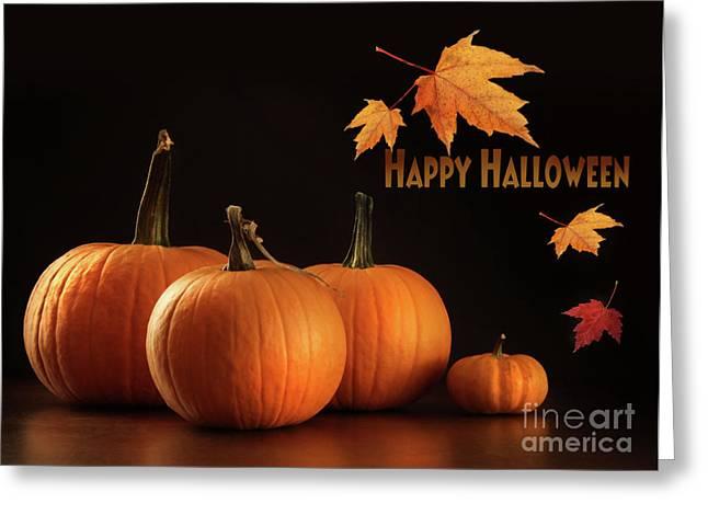 Jack-o-lanterns Greeting Cards - Colorful pumpkins on wood table on dark  Greeting Card by Sandra Cunningham