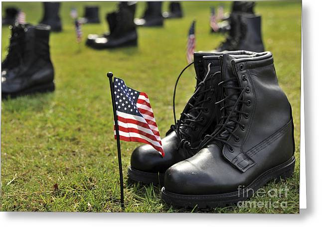 Black Boots Greeting Cards - Combat Boots Are Placed In Formation Greeting Card by Stocktrek Images