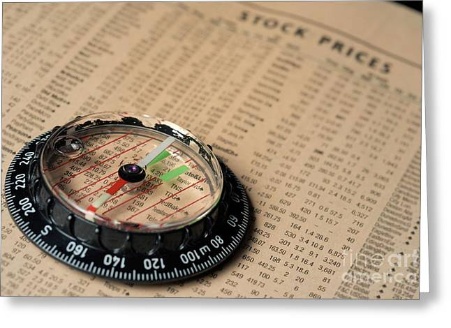 Compass on stockmarket cotation in newspaper Greeting Card by Sami Sarkis