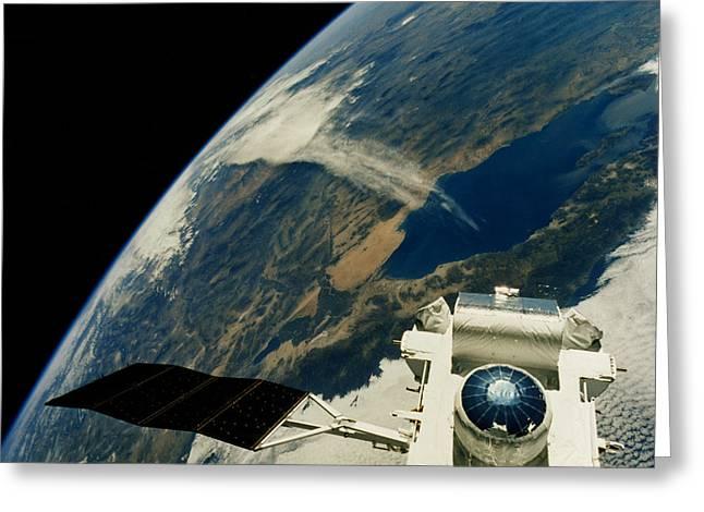 Atlantis Greeting Cards - Compton Observatory Satellite In Orbit Greeting Card by NASA / Science Source