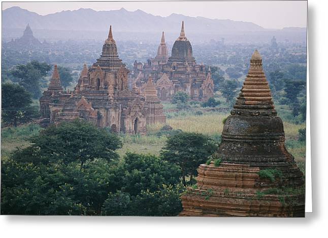 Indochinese Architecture And Art Greeting Cards - Cone Shaped Spires Top These Buddhist Greeting Card by Paul Chesley