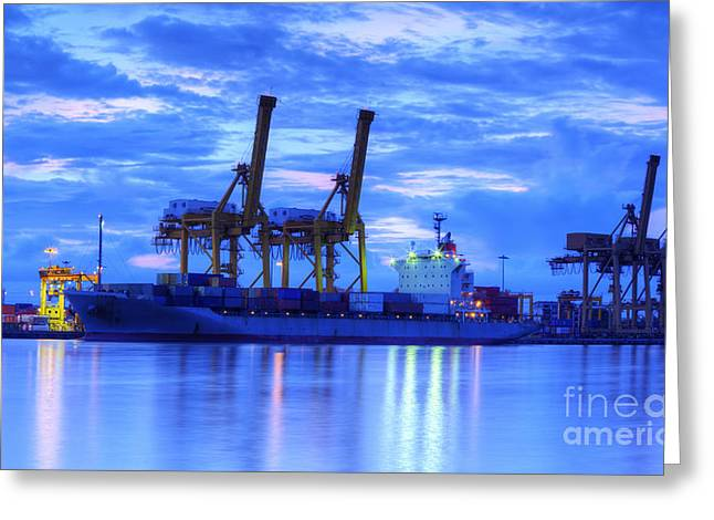 Container Cargo freight ship with working crane bridge in shipya Greeting Card by Anek Suwannaphoom