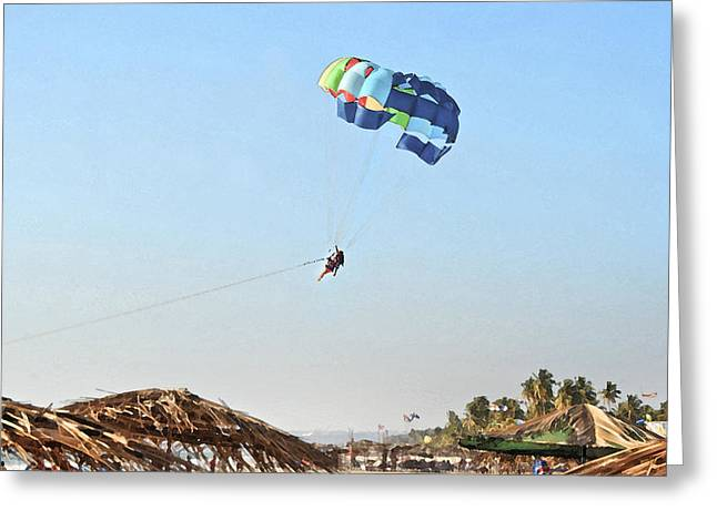 Couple parasailing over shacks Goa Greeting Card by Kantilal Patel