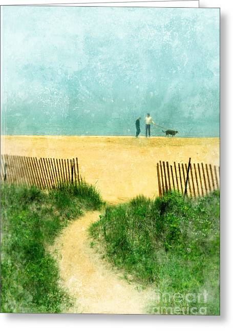 Couple Walking Dog On Beach Greeting Card by Jill Battaglia