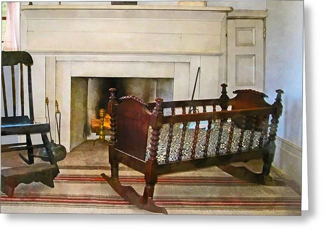 Cradle Near Fireplace Greeting Card by Susan Savad