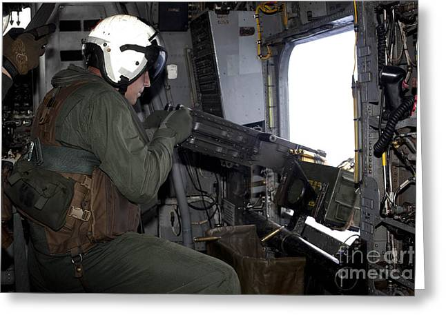 .50 Caliber Greeting Cards - Crew Chief Fires An M2 .50-caliber Greeting Card by Stocktrek Images