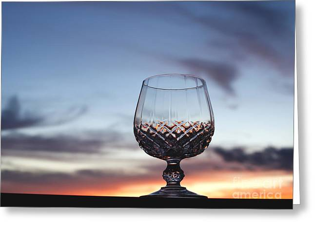 Cognac Greeting Cards - Crystal Glass against Sunset Greeting Card by Blink Images