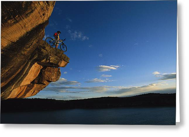 Dolores Greeting Cards - Cyclist Dan Davis Atop A Rock Overhang Greeting Card by Bill Hatcher