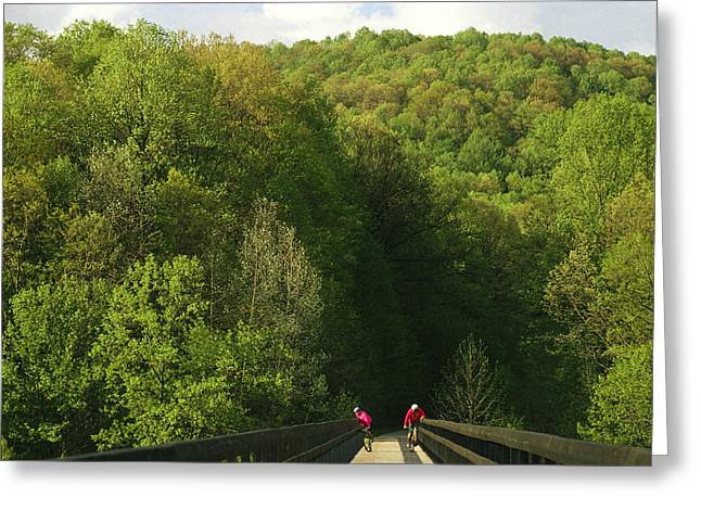 Middle Atlantic States Greeting Cards - Cyclists Cross A Bridge Greeting Card by Joel Sartore