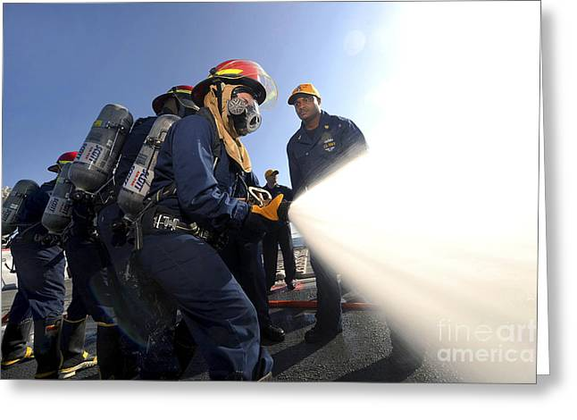 Oxygen Tank Greeting Cards - Damage Controlmen Conduct Fire Hose Greeting Card by Stocktrek Images