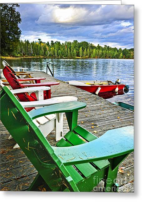 Deck Chairs Greeting Cards - Deck chairs on dock at lake Greeting Card by Elena Elisseeva