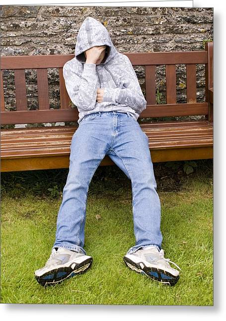 Park Benches Greeting Cards - Depressed Teenage Boy On Park Bench. Greeting Card by Mark Williamson
